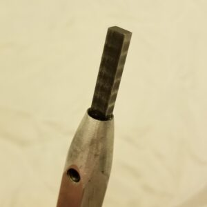 a glass scoring tools blade is shown.